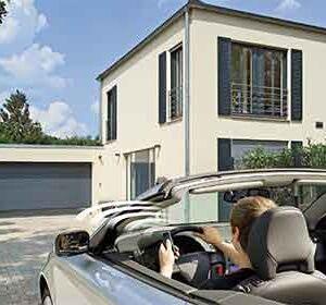 man driving up to garage door